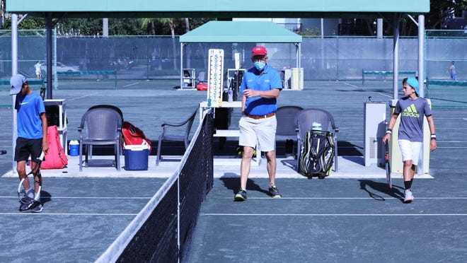 Players take the court for a match during the Delray Beach Junior Championships.