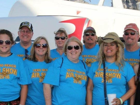 Volunteers with the Vero Beach Air Show take a break for a photo.
