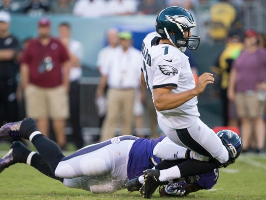 Ravens outside linebacker Terrell Suggs tackles Eagles quarterback Sam Bradford (7) late and is called for a penalty during Bradford's preseason debut at Lincoln Financial Field on Aug. 22.