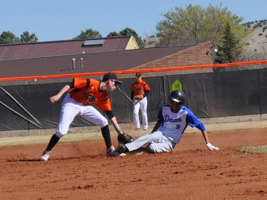 Capitan;'s John Rogers makes the catch to stop Dexter's