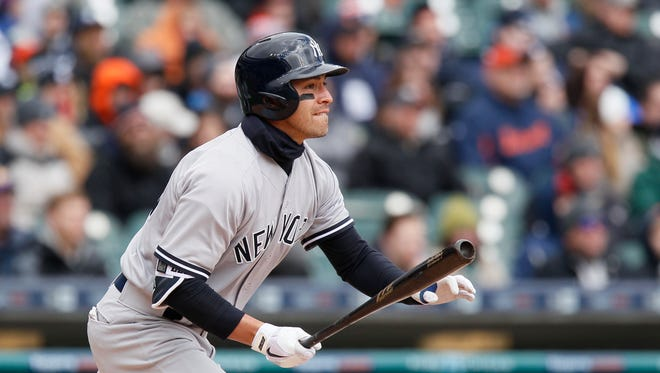 New York Yankees' Jacoby Ellsbury watches his three-RBI triple during the fourth inning of a baseball game Saturday, April 9, 2016, in Detroit. The Yankees defeated the Tigers 8-4.