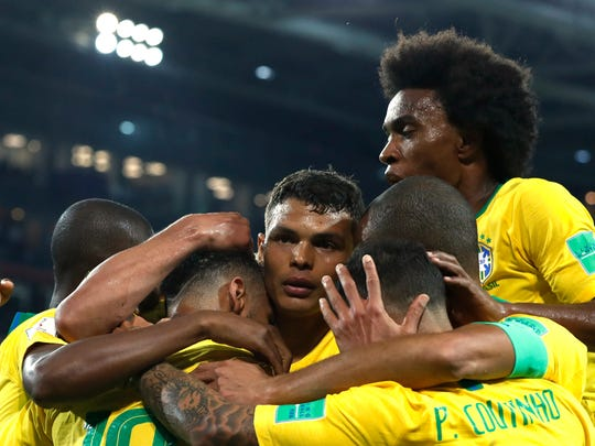 Brazil's Thiago Silva, middle, celebrates with teammates after scoring in a match against Serbia at the 2018 soccer World Cup on June 27.