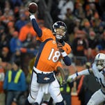 Denver Broncos quarterback Peyton Manning (18) throws a pass during the NFL divisional playoff game against the Indianapolis Colts at Sports Authority Field at Mile High Stadium in January.