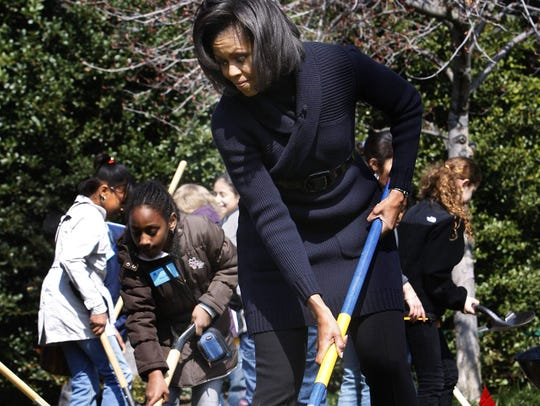 First Lady Michelle Obama takes part in the groundbreaking