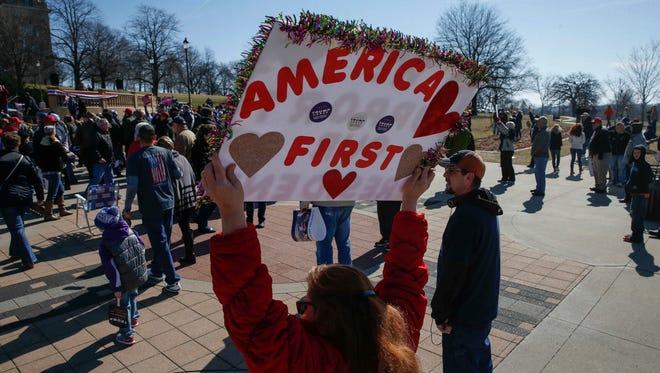 Supporters of President Donald Trump gathered on the west lawn of the Iowa Capitol Building grounds to rally for the president during the Spirit of America rally Saturday, March 4, 2017, in Des Moines. The rally, which was part of a nationwide rally to counter the recent protests, drew a couple hundred supporters.
