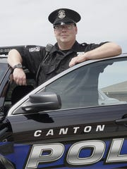 Jeffrey Seifert, Canton Police Officer of the Year, pauses from his road patrol to talk about his job.