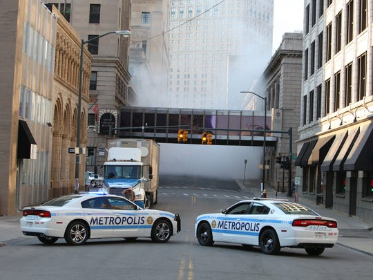 2 Metropolis police cars are on Shelby looking north to the Westin Hotel. Filming for the superhero movie Batman V. Superman: Dawn of Justice took place in downtown Detroit on Saturday, August 9, 2014. John Froelich/Special to the Free Press