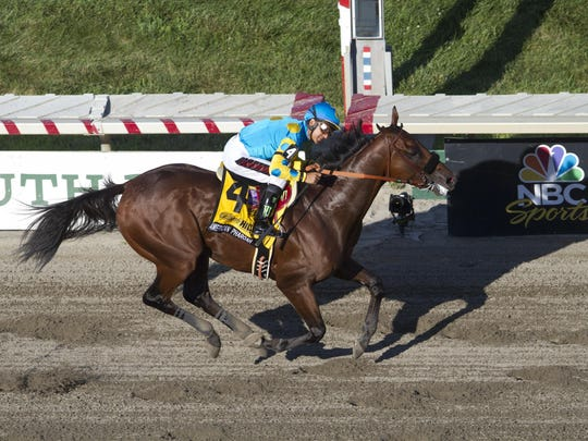 Triple Crown winner American Pharoah crosses the finish line in his impressive win Aug. 2 in the $1,750,000 Haskell.