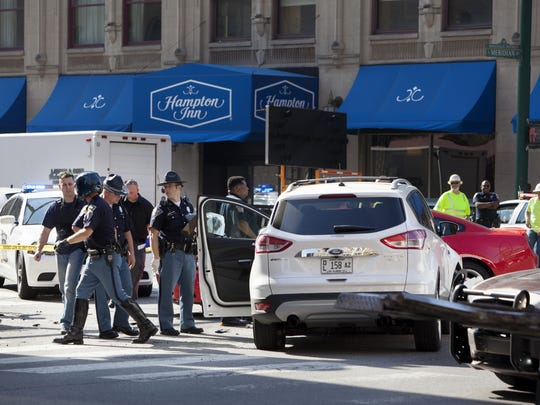 A police chase of a motorist traveling at speeds of up to 120 mph ended in a crash in Downtown Indianapolis on Thursday, May 8, 2014, where the motorist, driving a white Ford Explorer, struck a blue Ford Taurus at the intersection of Meridian and Maryland streets. The collision sent the Taurus spinning into a nearby bicyclist, who sustained leg and back injuries. The driver of the Taurus also was injured and was treated at the scene.