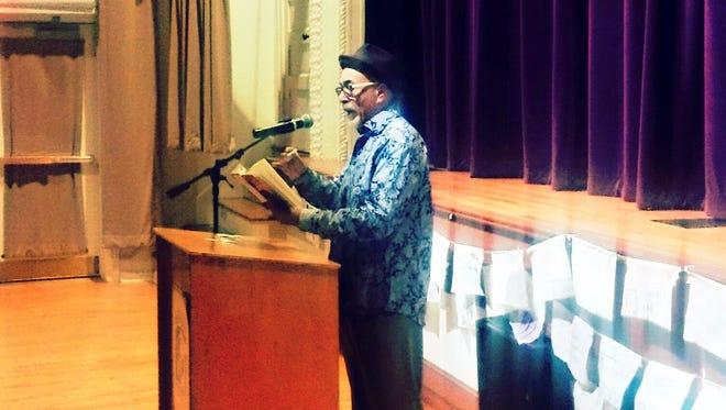 Juan Felipe Herrera reads one his poems before a WNMU audience.