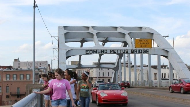 "Youth involved with FasTrac walked across the Edmund Pettus Bridge, where Alabama police confronted civil rights marchers on ""Bloody Sunday"" in 1965, during a 2012 civil rights tour stop in Selma, Ala."