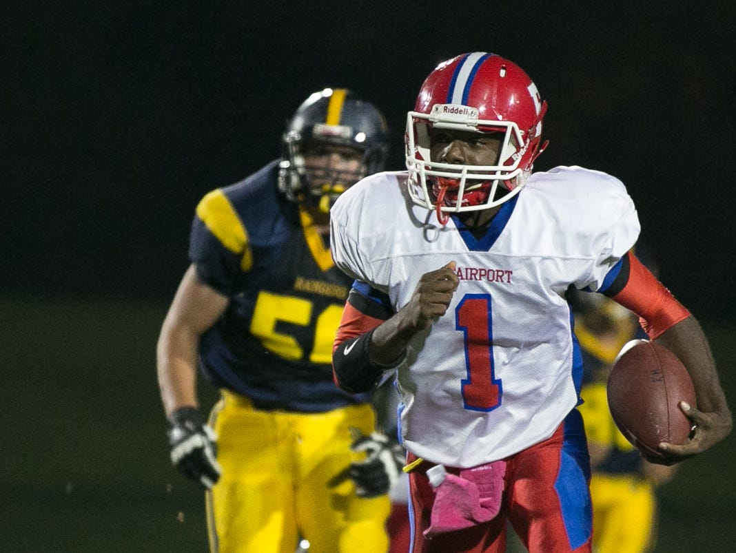 Fairport's Keshawn Howard carries the ball against Spencerport.