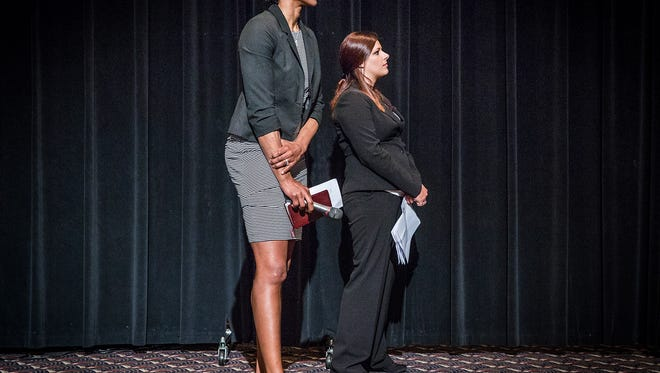Gold medalist and WNBA champion Tamika Catchings waits off stage to give a speech during the Fellowship of Christian Athletes Banquet at the Horizon Convention Center Thursday evening.