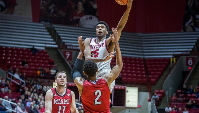 Ball State's Tahjai Teague shoots past Miami's defense during their game at Worthen Arena Tuesday, Jan. 10, 2016.