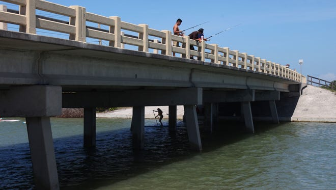 upgrades to the Little Carlos Pass bridge is one of three bridges the Lee County Commission may delay to free up time and money to finishthe Estero Boulevard road project early.