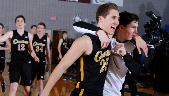 Lansing Christian's Andrew Prieskorn (25) and Matt Havey, right, and teammates celebrate following their win over Benton Harbor Dream Academy their MHSAA Class D quarterfinal game, Tuesday, March 21, 2017, in Kalamazoo, Mich. Lansing Christian won 65-47.