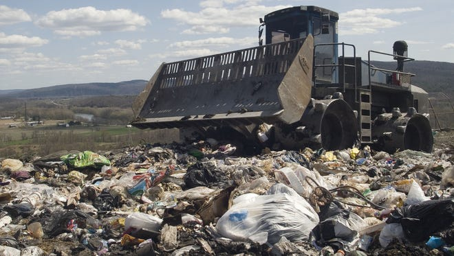 Heavy equipment is used to compact trash before it is covered with dirt at the Chemung County landfill in 2010.