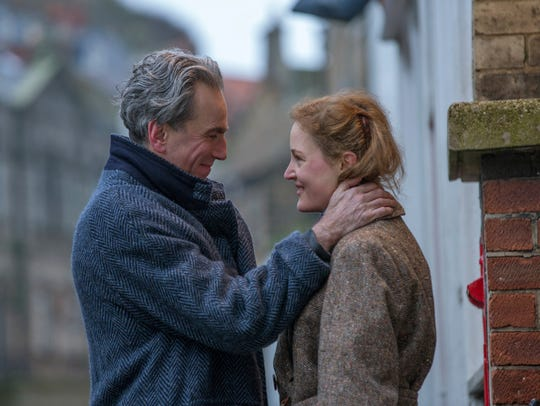 Daniel Day-Lewis, left, and Vicky Krieps appear in