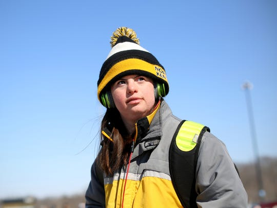 Jillian Daugherty, 25, waits for the TANK bus after finishing her job at Northern Kentucky University, where she is the men's basketball manager -- a job she's held since 2010.