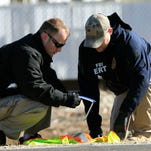 FBI agents look at evidence outside Excel Industries in Hesston, Kan., The deadly assault  at the lawnmower parts plant ended when a police officer killed the gunman during a shootout.