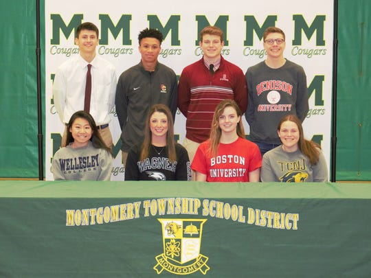 (Bottom row left to right): Montgomery's Rosey Li, Michelle D'Allegro, Kara Lydzinski and Kaitlin Kocinski. (Standing left to right): Joe Mercurio, Malachi Clemons, Nicolas Ipeker and John Stauffer all signed their National Letters of Intent on Thursday morning.