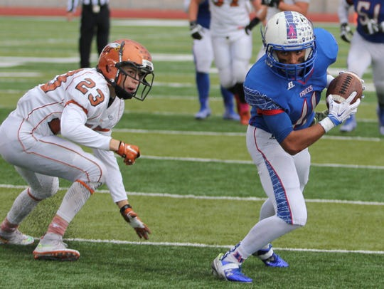 Las Cruces High's Ivan Molina looks to the endzone