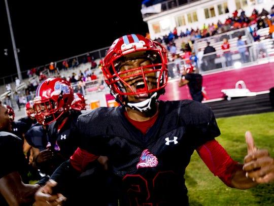 Austin-East's Jahson Jackson (23) reacts after a touchdown