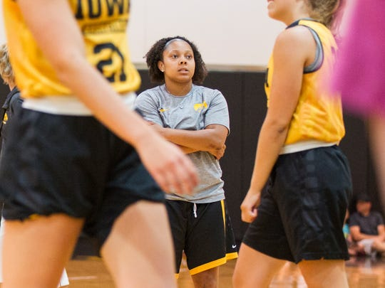 Iowa guard Tania Davis watches teammates during a women's
