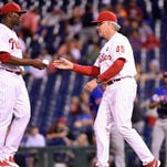 Aug 27, 2015; Philadelphia, PA, USA; Philadelphia Phillies interim manager Pete Mackanin (45) takes the ball from relief pitcher Hector Neris (50) during thirteenth inning against the New York Mets at Citizens Bank Park. The Mets defeated the Phillies, 9-5 in 13 innings. Mandatory Credit: Eric Hartline-USA TODAY Sports