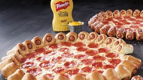 Pizza Hut's newest pizza includes a 28-hot dog crust.