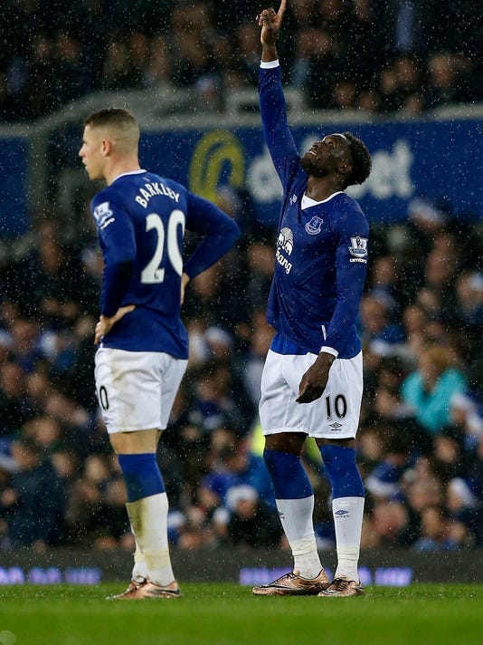 Everton's Romelu Lukaku celebrates scoring against Leicester City during the English Premier League soccer match at Goodison Park, Liverpool, England, Saturday Dec. 19, 2015. (Peter Byrne/PA via AP) UNITED KINGDOM OUT