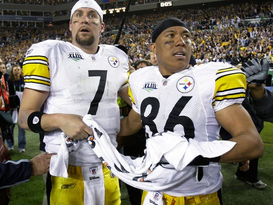 FILE - In this Feb. 1, 2009, file photo, Pittsburgh Steelers' Ben Roethlisberger, left, and Hines Ward stand on the field after the Steelers defeated the Arizona Cardinals 27-23 in NFL football's Super Bowl XLIII in Tampa, Fla. (AP Photo/Chris O'Meara, File)