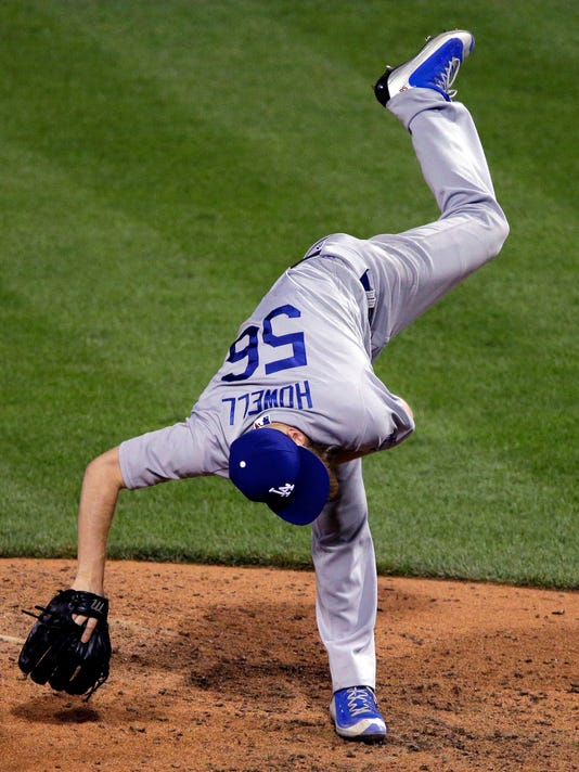 Los Angeles Dodgers reliever J.P. Howell follows through on a pitch during the sixth inning of the team's baseball game against the Pittsburgh Pirates in Pittsburgh, Friday, June 24, 2016. The Pirates won 8-6. (AP Photo/Gene J. Puskar)