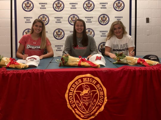 From left to right: Voorhees' Emily Zobian, Allie Best and Hannah Schiavo sign their National Letters of Intent on Tuesday.