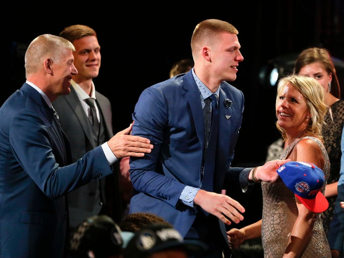 Henry Ellenson, center, is congratulated by friends