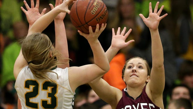 Freedom's Jordan Kempen (23) puts up a shot over Megan Mellberg of Fox Valley Lutheran during Friday's game in Freedom.