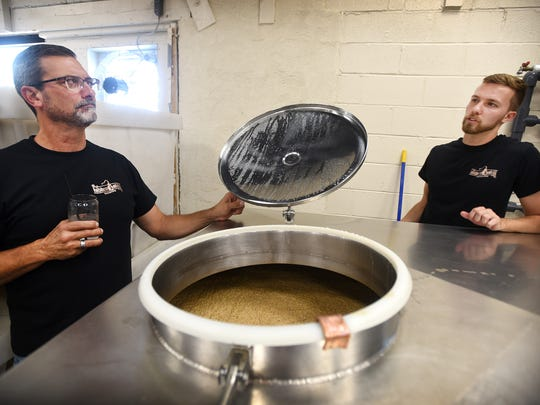 "David Stein and his son, Chris Stein, look over a mash at Hidden Stills. A liquor reform law, Act 39 of 2016, is having an immediate impact on Lebanon business Hidden Still Spirits. The new law allows Hidden Still to sell any Pennsylvania licensed beer or wine in their distillery for on-site consumption. Owner David Stein says, ""It's allowed us to expand our footprint."""