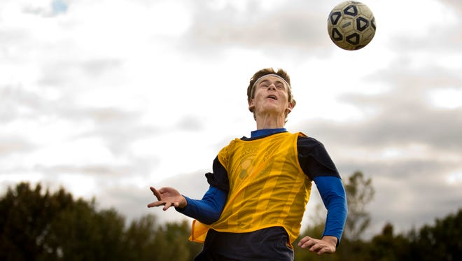 Alex Meiniche, an exchange student from Denmark, heads the ball during soccer practice Friday, October 9, 2015 at Richmond High School.