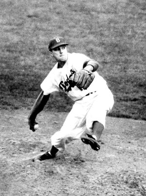 Brooklyn Dodgers pitcher Carl Erskine, shown pitching in the 1953 World Series against the New York Yankees, pitched the first two Dodgers no-hitters to be called by Vin Scully.