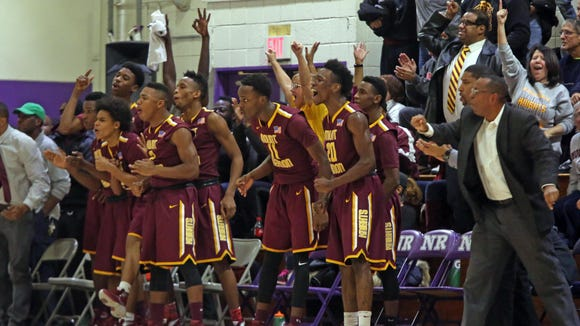 The Mount Vernon bench and fans celebrate when the