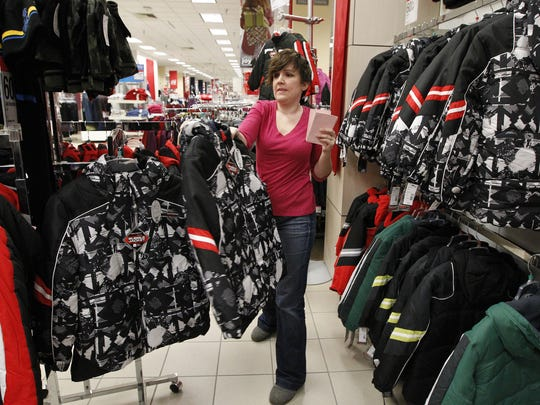 Elizabeth Spinsby shops for winter coats at the Sears store in Merle Hay Mall in 2011. Sears closed Sunday after 58 years at the mall. The company announced Monday that it was filing for bankruptcy reorganization.