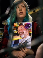 Holly Nanning holds a picture of mass shooting victim and friend Daniel Kaufman during a candlelight vigil in San Bernardino, California, USA, 03 December 2015.