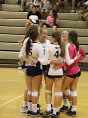 The Estero volleyball celebrates a winning point during a recent early-season match.