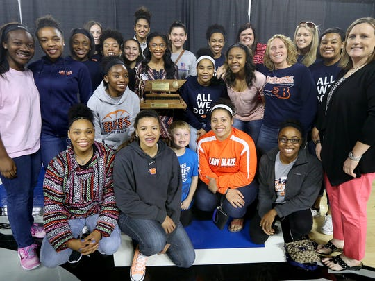 Blackman's Crystal Dangerfield is surrounded by her teammates and coaches after winning the Class AAA Miss Basketball award, on Tuesday, March 8, 2016, at MTSU