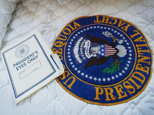 "A ""President's Eyes Only"" folder lies on the bed used"