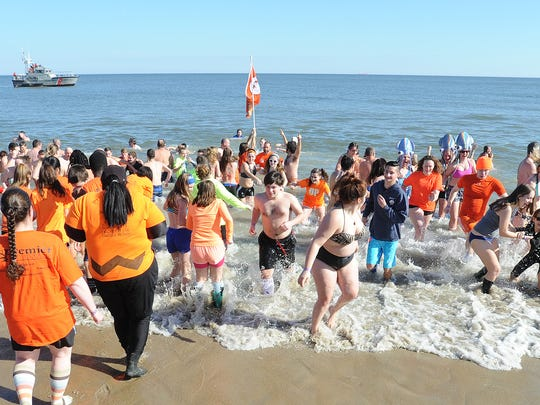 "More than 3,500 ""Bears"" braved air temps of 49 degrees and water temps of 41 degrees at the 26th annual Lewes Polar Bear Plunge, held at Rehoboth Beach. The event raises money for Delaware Special Olympics."