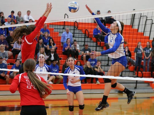 Action is intense at the net Monday, as Salem's Kendall