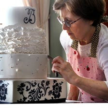 Tanya Marshall of Heavenly Sweets in Noblesville works on a cake with a damask pattern and ruffles. NerdWallet.com recently named Hamilton County most affordable place to married in the state.