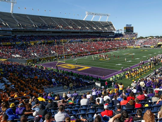 A wide angle view of the stadium during the second half of an NCAA football game between the LSU Tigers and the Louisville Cardinals in the Buffalo Wild Wings Citrus Bowl at Camping World Stadium. The Tigers won 29-9.