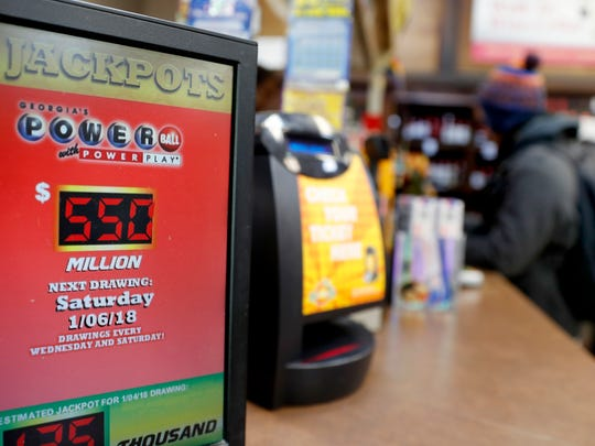 A sign advertises the Powerball lottery jackpot at